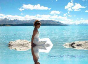 Bride in the lake for her dream wedding at Lake Pukaki