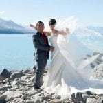 Couple on the shores of Lake Pukaki for their dream Lake Pukaki Wedding